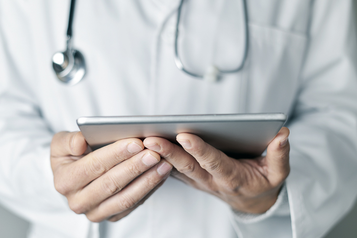 doctor holding a electronic tablet
