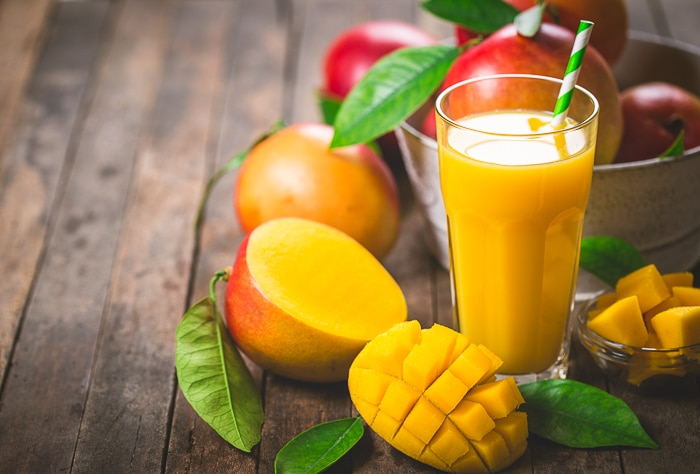 mango juice and mango slices offered on table