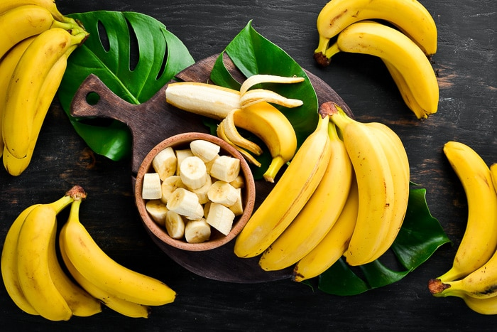 bananas and banana slices in a wood bowl