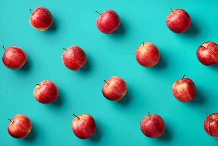 red apples on aqua backdrop