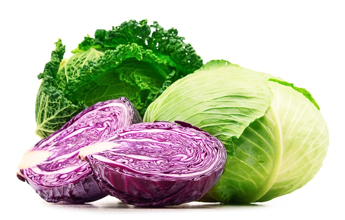 red and green cabbage being chopped and served