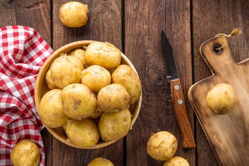 yellow potatoes in bowl with picnic cloth